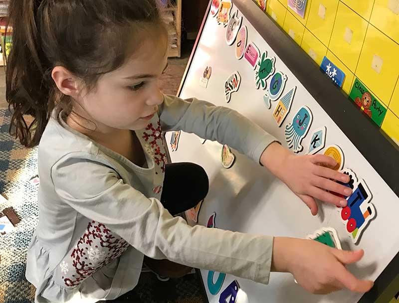 Photo of a little girl in our pre-kindergarten class in Methuen Massachusetts.