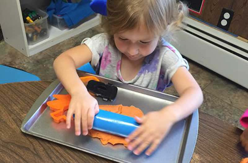 Photo of little girl in our Methuen Massachusetts preschool.