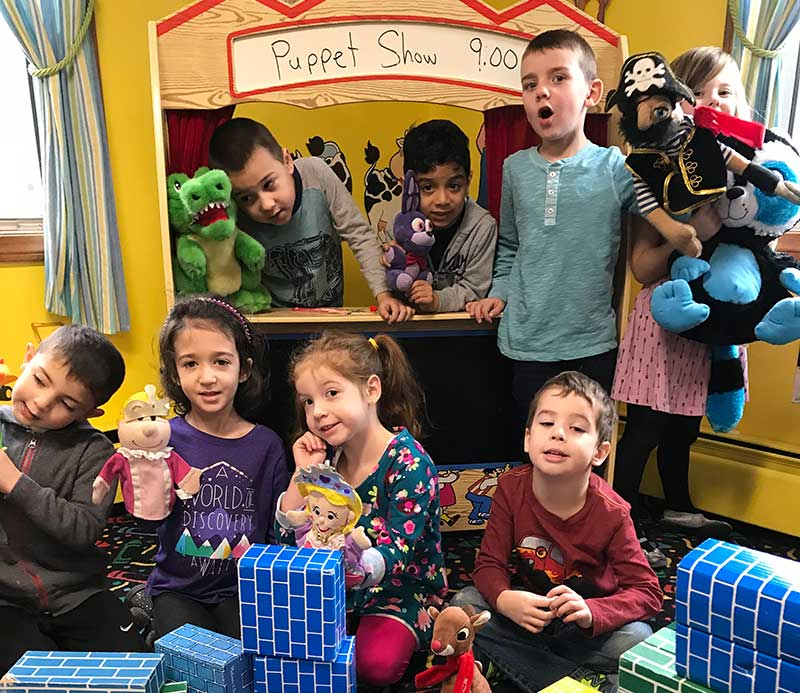Photo of Growing Years preschoolers puting on a puppet show at your Methuen Massachusetts preschool